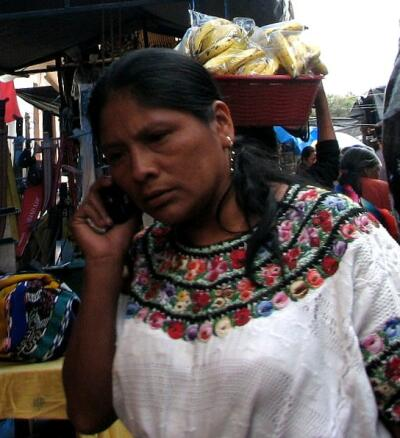 Guatemalan woman using cell phone