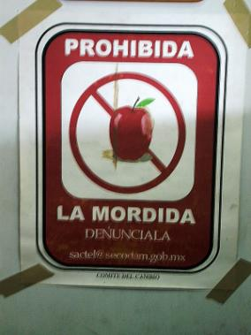 Acapulco poster: Mordida is prohibited, report it!